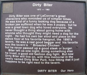 Plaque telling the story of Dirty Biter, The Wabi-Sabi Town Dog of  La Conner Washington